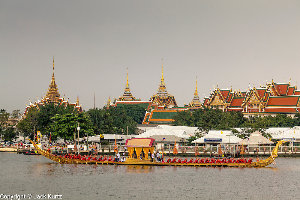 06 NOVEMBER 2012 - BANGKOK, THAILAND:  The Royal Barge Suphannahong is propelled down the Chao Phraya River, rowed by 50 oarsmen in the dress rehearsal for the Royal Barge Procession. Thailand's Royal Barge Procession has both religious and royal significance. The tradition is nearly 700 years old. The Royal Barge Procession takes place rarely, typically coinciding with only the most important cultural and religious events. During the reign of King Bhumibol Adulyadej, spanning over 60 years, the Procession has only occurred 16 times. The Royal Barge Procession consists of 52 barges: 51 historical Barges, and the Royal Barge, the Narai Song Suban, which King Rama IX built in 1994. It is the only Barge built during King Bhumibol's reign. These barges are manned by 2,082 oarsmen. The Procession proceeds down the Chao Phraya River, from the Wasukri Royal Landing Place in Bangkok, passes the Grand Palace complex and ends at Wat Arun. Tuesday's dress rehearsal was the final practice for the 2012 Royal Barge Procession, which takes place November 9.  PHOTO BY JACK KURTZ