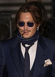 © Licensed to London News Pictures. 26/02/2020. London, UK. American Actor Johnny Depp (C) leaves the High Court in London. Johnny Depp is in a legal dispute with a UK tabloid newspaper. Photo credit: Peter Macdiarmid/LNP