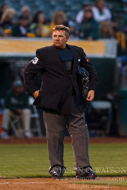 OAKLAND, CA - AUGUST 02: MLB umpire Greg Gibson #53 stands behind home plate during the fourth inning between the Oakland Athletics and the Toronto Blue Jays at O.co Coliseum on August 2, 2012 in Oakland, California. The Oakland Athletics defeated the Toronto Blue Jays 4-1. (Photo by Jason O. Watson/Getty Images) *** Local Caption *** Greg Gibson