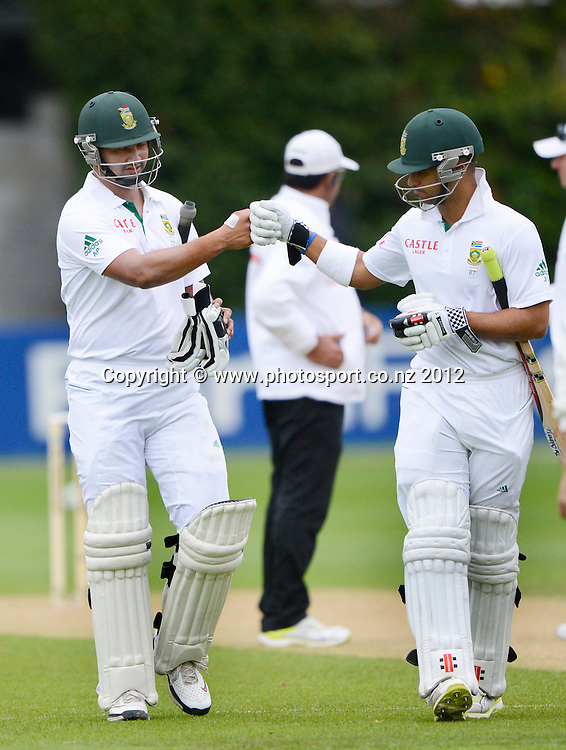 South Africa's Alviro Petersen (L) punches gloves with Jean-Paul Duminy as they leave the field for bad light. Third Test, Day 2. New Zealand Black Caps versus South Africa Proteas, Basin Reserve, Wellington, New Zealand. Saturday 24 March 2012. Photo: Andrew Cornaga/Photosport.co.nz