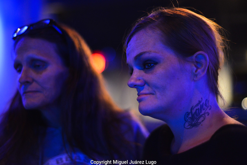 "Chasity Holt, a 36-year-old heroin addict, listens with her mother Amy to a sermon at City on a Hill church in Cincinnati, Ohio. ""I used to be a good person,"" says Chasity, who showed up at the church as a last resort, saying that she had overdosed only the day before.  ""I stole, I lied, I cheated, I burned so many bridges,"" she says of her life as an addict, which began with drinking, moved to crack, to painkillers and finally heroin. ""My kids they were there witnessing all this."" She has five kids, two of whom live with a relative and three live with her and her mother."