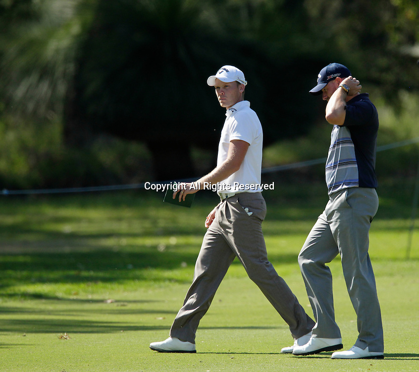18.10.2013 Perth, Australia. Danny Willett (ENG) and Craig Lee (SCO) walk together on the 13th fairway during day 2 of the ISPS Handa Perth International Golf Championship from the Lake Karrinyup Country Club.