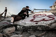 Dec. 29, 2015 - Aleppo, Syria - <br /> <br /> Syria Conflict<br /> <br /> Love Heart painted on the ruins of buildings destroyed by Syrian government forces by Nour .Nour lost his leg following a bomb barrel attack by forces of Syria's President Bashar al-Assad near his house in Bustan al-Qasr district. A report from the Syrian Observatory for Human Rights (SOHR) claims that over 1,000 children have been killed in airstrikes during the nation'ongoing civil war, an additional 1.5 million people have been wounded for life in the airstrikes that have been carried out by Syria, government since the Syrian conflict.<br /> ©Exclusivepix Media
