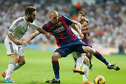 25.10.2014, Estadio Santiago Bernabeu, Madrid, ESP, Primera Division, Real Madrid vs FC Barcelona, 9. Runde, im Bild Real Madrid´s Daniel Carvajal and Luka Modric (R) and Barcelona´s Mathieu (C) // during the Spanish Primera Division 9th round match between Real Madrid CF and FC Barcelona at the Estadio Santiago Bernabeu in Madrid, Spain<br /> <br /> ***** NETHERLANDS ONLY *****