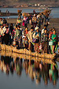 Commuters reflected in Chindwin River