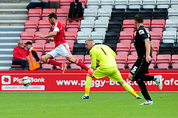 Bristol City's Sam Baldock rounds Bournemouth's Ryan Allsop - Photo mandatory by-line: Dougie Allward/JMP - Tel: Mobile: 07966 386802 27/03/2013 - SPORT - FOOTBALL - Goldsands Stadium - Bournemouth -  Bournemouth V Bristol City - Pre Season friendly