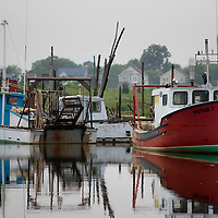 Commercial fishing boats in port at the Belford Seafood Co-Operative in Belford New Jersey