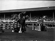 05/08/1960<br /> 05/08/1960<br /> 05 August 1960<br /> R.D.S Horse Show Dublin (Friday). Aga Khan Trophy. Lieut-Col. Carlos Delia (Argentina) on &quot;Huipil&quot;, clearing the last jump in the Aga Khan  Trophy Event at the Dublin Horse Show.