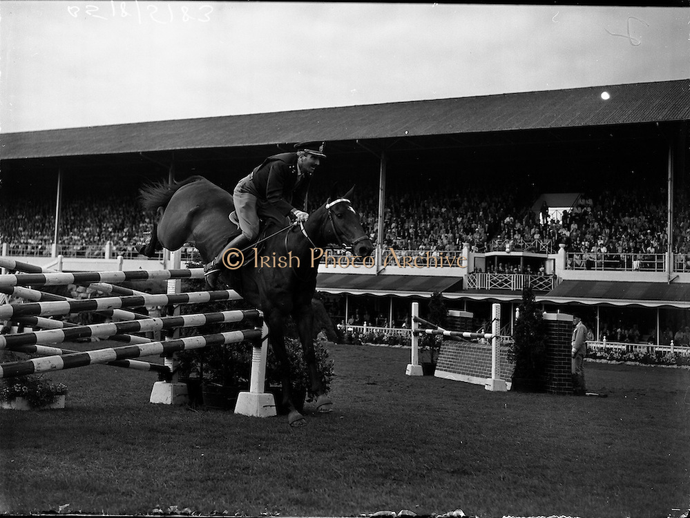 "05/08/1960<br /> 05/08/1960<br /> 05 August 1960<br /> R.D.S Horse Show Dublin (Friday). Aga Khan Trophy. Lieut-Col. Carlos Delia (Argentina) on ""Huipil"", clearing the last jump in the Aga Khan  Trophy Event at the Dublin Horse Show."