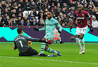 Football - 2018 / 2019 Premier League - West Ham United vs. Arsenal<br /> <br /> Alexandre Lacazette of Arsenal is foiled by Goalkeeper, Lukasz Fabianski, Angelo Ogbonna (right) at The London Stadium.<br /> <br /> COLORSPORT/ANDREW COWIE
