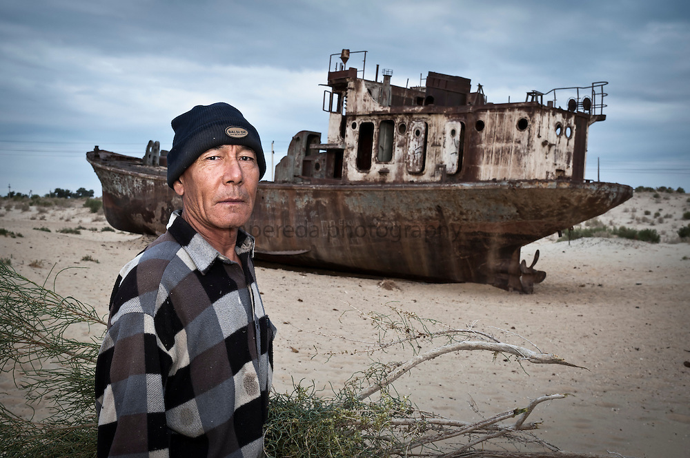 Moynaq. A shepherd next to an abandoned ship.