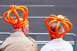 LONDON, UK  29/04/2011. The Royal Wedding of HRH Prince William to Kate Middleton. An elderly couple wearing inflatable orange crowns secure their front row spot in Parliament Square. Photo credit should read CLIFF HIDE/LNP. Please see special instructions. © under license to London News Pictures