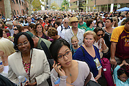 Polar Purev of Mongolia waits in the line of people waiting to get through security for the Papal mass which stretched two blocks at noon near the Benjamin Franklin Parkway Sunday September 27, 2015 in Philadelphia, Pennsylvania.  (Photo By William Thomas Cain)