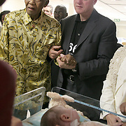 July 13, 2006 - President Bill Clinton and President Nelson Mandela visit sick children at the Walter Sisulu Pediatric Cardiac Center in Johannesburg, South Africa, during Clinton's tour of Africa to raise money and awareness about the work of the Clinton Foundation. Photo by Evelyn Hockstein