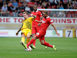 Chris Lines of Bristol Rovers is challenged by Sammy Moore of Leyton Orient - Mandatory byline: Neil Brookman/JMP - 07966386802 - 29/08/2015 - FOOTBALL - Matchroom Stadium -Leyton,England - Leyton Orient v Bristol Rovers - Sky Bet League Two
