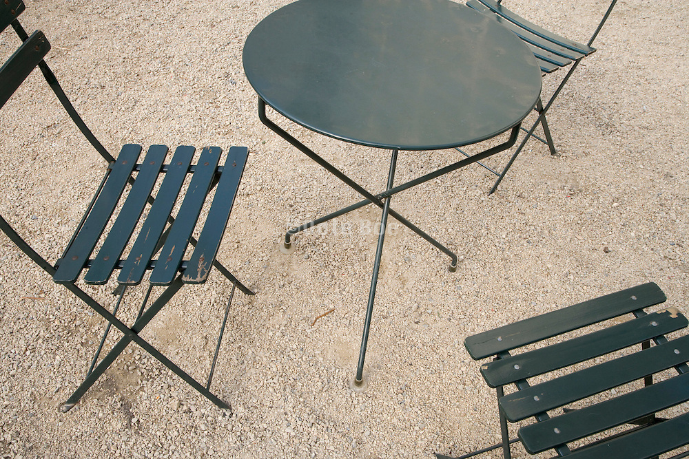 close up with 3 park chairs and a round table