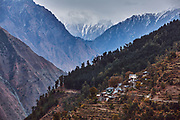 Barai village with snowclad mountains in the background in Bharmour, Chamba, Himachal Pradesh, India