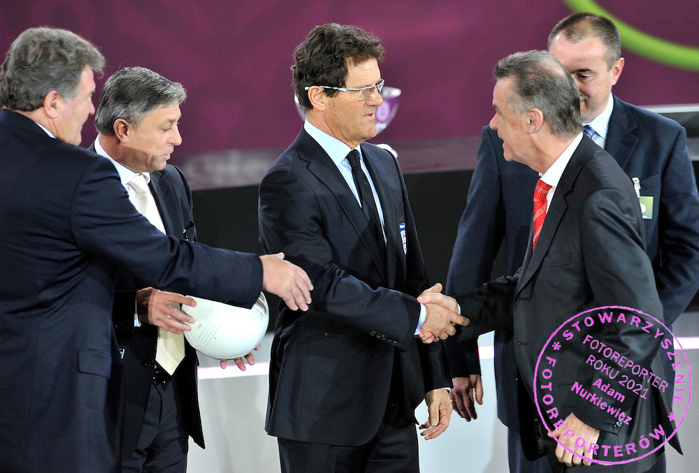 (C) ENGLAND FOOTBALL COACH FABIO CAPELLO SHAKES HANDS WITH (R) OTTMAR HITZFELD COACH OF SWITZERLAND ALONGSIDE (L) JOHN TOSHACK COACH OF WALES AND (2L) ZLATKO KRANJCAR COACH OF MONTENEGRO AFTER THE EUFA EURO 2012 QUALIFYING DRAW IN PALACE SCIENCE AND CULTURE IN WARSAW, POLAND..THE 2012 EUROPEAN SOCCER CHAMPIONSHIP WILL BE HOSTED BY POLAND AND UKRAINE...WARSAW, POLAND , FEBRUARY 07, 2010..( PHOTO BY ADAM NURKIEWICZ / MEDIASPORT )..PICTURE ALSO AVAIBLE IN RAW OR TIFF FORMAT ON SPECIAL REQUEST.