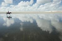 Horseback rider on beach, Jericoacoara, Brazil