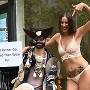 A half naked PETA activists demonstration against fur and company supports animals cruelty at London Fashion Week at Strand, UK 15 September 2018.