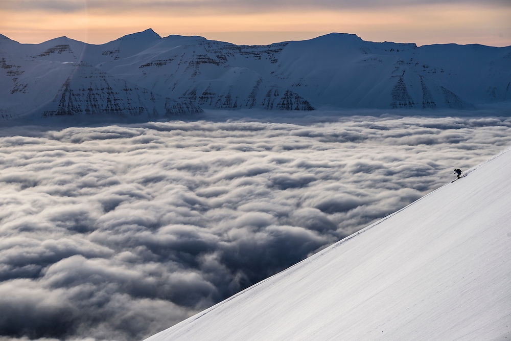 Brittany Mumma skis above a seas of clouds in North Iceland