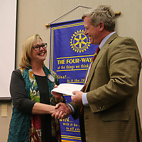 Tupelo Rotary Club President Jenny Jones, left, gives Lee County Library Director Jeff Tomlinson a check for the library's summer reading program Monday afternoon. The Club handed out four grants totaling $10,000 to local groups.