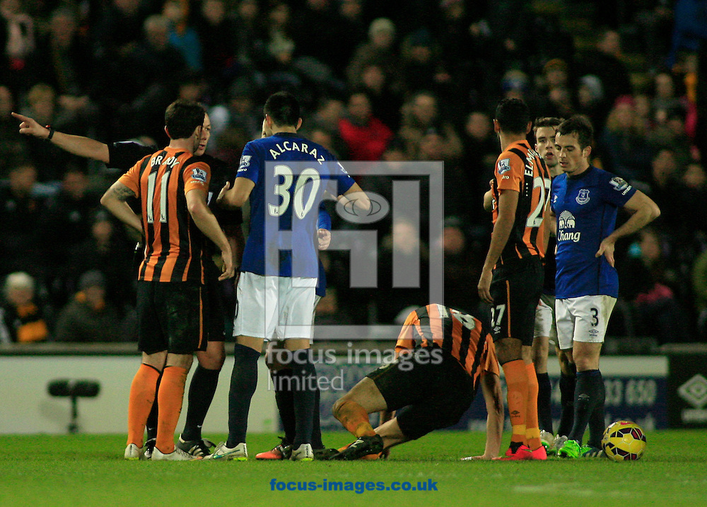 Ref Kevin Friend tells Antolin Alcaraz of Everton to leave the field after receiving a red card for the foul on Nikica Jelavic of Hull City  during the Barclays Premier League match at KC Stadium, Hull<br /> Picture by Richard Gould/Focus Images Ltd +44 7855 403186<br /> 01/01/2015