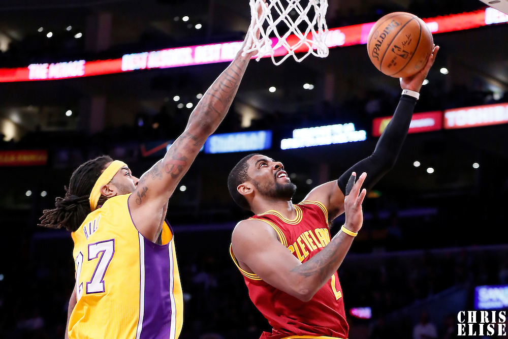 15 January 2015: Cleveland Cavaliers guard Kyrie Irving (2) goes for the layup past Los Angeles Lakers center Jordan Hill (27) during the Cleveland Cavaliers 109-102 victory over the Los Angeles Lakers, at the Staples Center, Los Angeles, California, USA.