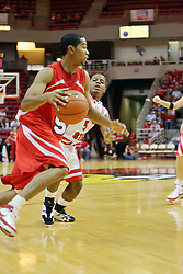 "11 November 2007: Jason Black drives against Keith ""Boo"" Richardson. Illinois State Redbirds defeated the Missouri - St. Louis Tritons 70-37 in an early season game on Doug Collins Court in Redbird Arena on the campus of Illinois State University in Normal Illinois."