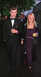 MR LARRY OBYRNE and MISS ALICE BAMFORD, daughter of Sir Anthony Bamford from the family that owns the company that makes JCB diggers, at a party in London on 5th June 1999.MSX 62