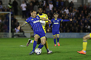 Barry Fuller (Captain) defender for AFC Wimbledon (2) and Tarique Fosu-Henry striker Accrington Stanley (30) tussle during Sky Bet League 2 Play-Off first leg match between AFC Wimbledon and Accrington Stanley at the Cherry Red Records Stadium, Kingston, England on 14 May 2016. Photo by Stuart Butcher.