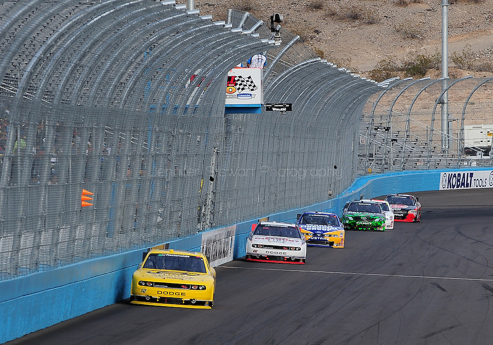 Nov. 12 2011; Avondale, AZ, USA; NASCAR Nationwide Series driver Sam Hornish Jr. (12) leads Brad Keseloski (22) , Carl Edwards (60) and Joey Logano (18) during the Wypall 200 at Phoenix International Raceway. Mandatory Credit: Jennifer Stewart-US PRESSWIRE