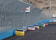 Nov. 12 2011; Avondale, AZ, USA; NASCAR Nationwide Series driver Sam Hornish Jr. (12) leads Brad Keseloski (22) , Carl Edwards (60) and Joey Logano (18) during the Wypall 200 at Phoenix International Raceway. Mandatory Credit: Jennifer Stewart-US PRESSWIRE