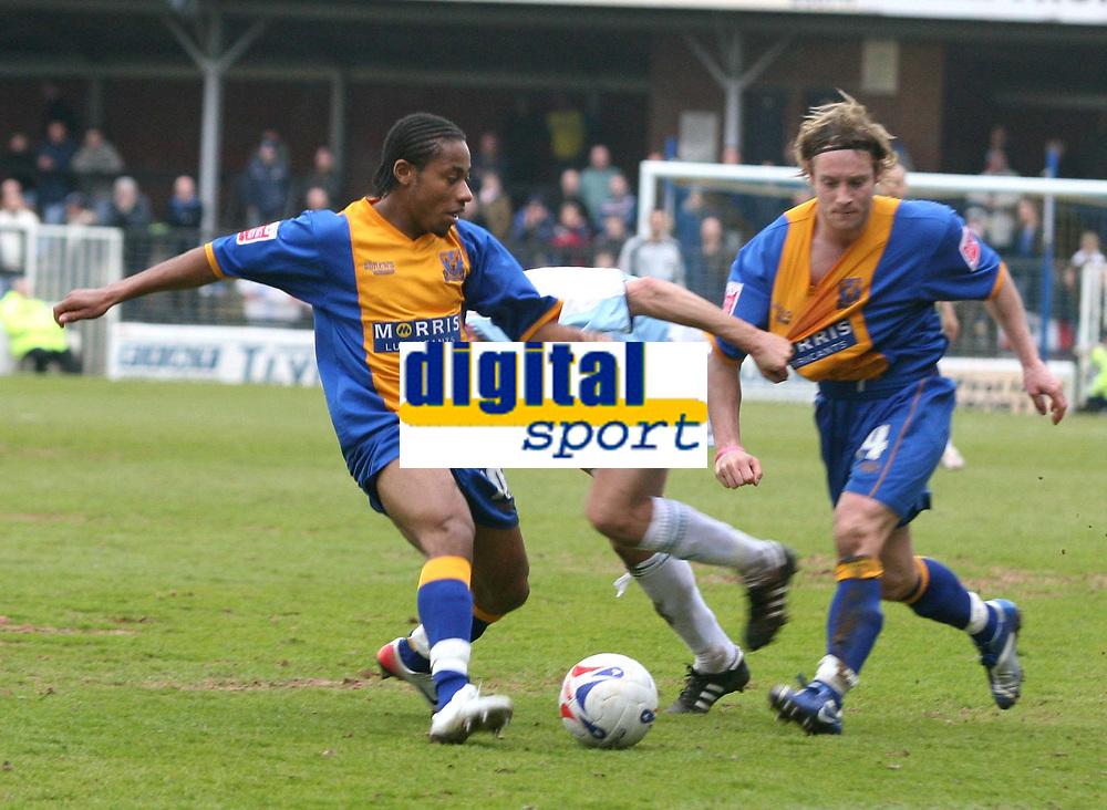 Photo: Mark Stephenson.<br />Shrewsbury Town v Torquay United. Coca Cola League 2. 24/03/2007. Shrewsbury's Derek Asamoah (L) helps team mate Ben Davies out of a spot