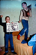 Neville and Symond with Cockney Rejects poster, Hawthorne Road, High Wycombe, UK, 1980s.