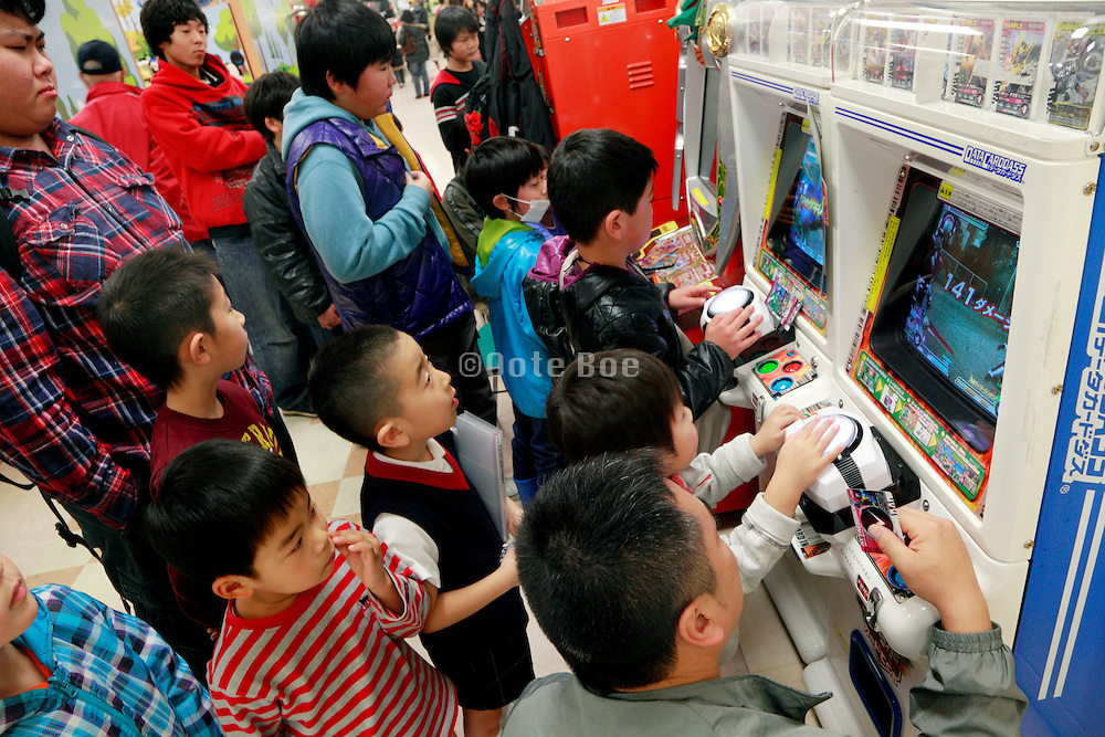 Japanese children at the computer gaming section in a department store