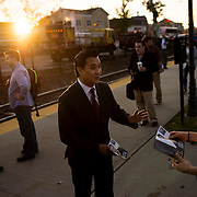 October 17, 2014 - Westwood, N.J. : Democrat Roy Cho, center, greets commuters as he campaigns at the Westwood NJ Transit station on Friday morning. A candidate for Congress from NJ's 5th District, Cho is challenging Rep. Scott Garrett in the upcoming November elections. CREDIT: Karsten Moran for The New York Times