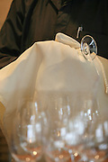 Waiter polishes glasses before setting the table