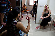 "American Jennifer (center, blond), 38, chats with other surrogacy clients as they wait in the Akanksha Infertility Clinic in the small town of Anand, Gujarat, India. Jennifer wants to try surrogacy after 5 unexplained failed pregnancies, ""I would go and pick a baby up from the street, which I wouldn't really but that's the kind of desperation that comes from infertility."" The Akanksha Infertility Clinic is known internationally for its surrogacy program and currently has over a hundred surrogate mothers pregnant in their environmentally controlled surrogate houses."