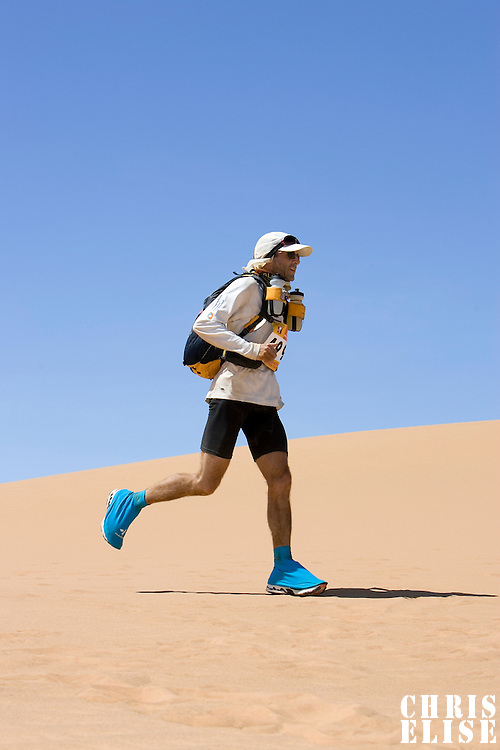 30 March 2007: #499 Andrew Cohen of Australia runs in erg Znaigui en route to check point 3 during fifth stage of the 22nd Marathon des Sables between west of Kfiroun and erg Chebbi (26.22 miles). The Marathon des Sables is a 6 days and 151 miles endurance race with food self sufficiency across the Sahara Desert in Morocco. Each participant must carry his, or her, own backpack containing food, sleeping gear and other material.