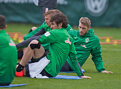 28.03.2014, Trainingsgelaende, Bremen, GER, 1. FBL, Werder Bremen, Training, im Bild Aaron Hunt (Bremen #14) beim Dehnen // Aaron Hunt (Bremen #14) beim Dehnen during a Trainingssession of German Bundesliga Club SV Werder Bremen at the Trainingsgelaende in Bremen, Germany on 2014/03/28. EXPA Pictures © 2014, PhotoCredit: EXPA/ Andreas Gumz<br /> <br /> *****ATTENTION - OUT of GER*****