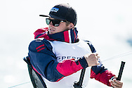 Miami - January 29, 2015.  Close-up of a skipper at the helm of a Skud 18 in the Paralympic class at the 2015 ISAF Sailing World Cup in Miami.