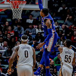 Dec 10, 2017; New Orleans, LA, USA; Philadelphia 76ers forward Richaun Holmes (22) dunks over New Orleans Pelicans center DeMarcus Cousins (0) and guard E'Twaun Moore (55) during the second quarter of a game at the Smoothie King Center. Mandatory Credit: Derick E. Hingle-USA TODAY Sports