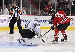 Oct 21; Newark, NJ, USA; New Jersey Devils left wing Zach Parise (9) scores a short handed penalty shot goal on San Jose Sharks goalie Antti Niemi (31) during the second period at the Prudential Center.