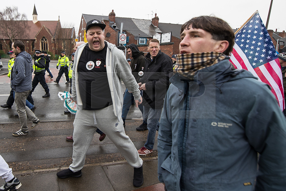 © Licensed to London News Pictures . 20/01/2018. Doncaster, UK. EDL protesters march through Hexthorpe on the way to the demonstration . Far-right street protest movement , the English Defence League ( EDL ) , hold a demonstration , opposed by anti-fascists , including Unite Against Fascism ( UAF ) in the Hexthorpe area of Doncaster . EDL supporters chanted anti-Roma slogans as they marched through the town . Photo credit: Joel Goodman/LNP