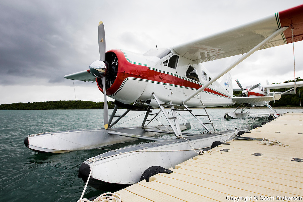 A Beaver and turbine otter on floats docked at Rapids Camp Lodge, a sport fishing lodge on the Naknek River in Bristol Bay, Alaska.