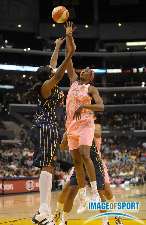Aug 9, 2010; Los Angeles, CA, USA; Los Angeles Sparks forward DeLisha Milton-Jones (8) is defended by Indiana Fever center Jessica Davenport (50) at the Staples Center. The Fever defeated the Sparks 82-76. Mandatory Credit: Kirby Lee/Image of Sport-US PRESSWIRE