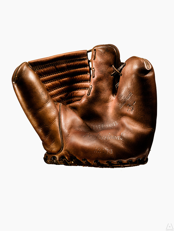A vintage Wilson two finger Fielder's Glove with remnants of the original logo on palm