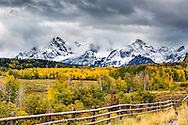 A stormy day at Ralph Lauren's Ranch in Ridgeway Colorado below the beautiful San Juan Mountains blanked in snow and autumn color