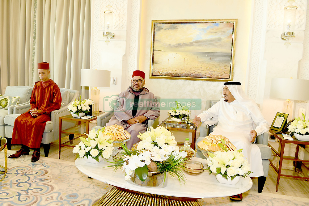 KIng of Morocco Mohammed VI (2nd from L) and his son Crown Prince Moulay El Hassan (left) visit King of Saudi Arabia or 'Custodian of Holy Sites' Salman Bin Abdulaziz Al Saud (center) in his residence in Tangiers, Morocco, on August 12, 2017. King Salman is spending several weeks holiday in Tangiers. Photo by Balkis Press/ABACAPRESS.COM